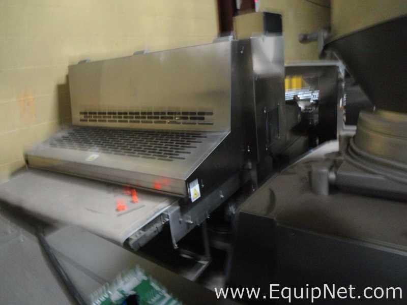 Cortador de guillotina Canol MCI 1250 con transportador